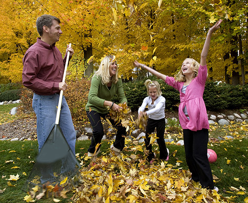 Ann ARbor family photography  raking leaves